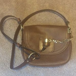 Michael Kors saddle bag from retail, not outlet.